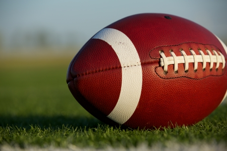 American Football Close Up on the Field with room for copy Stock Photo