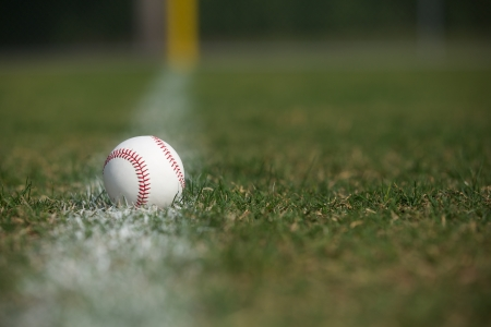 Baseball on the Outfield Chalk Line with room for copy Stock Photo - 22268275