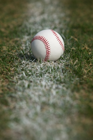 Baseball on the Outfield Chalk Line Stock Photo - 22268276