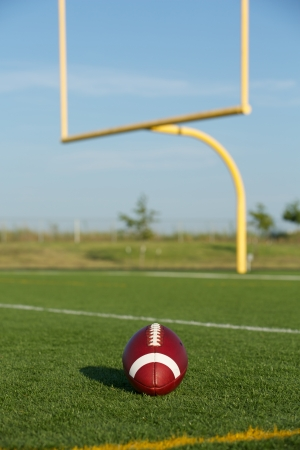 uprights: American Football on the Field with Goalposts or Uprights Beyond