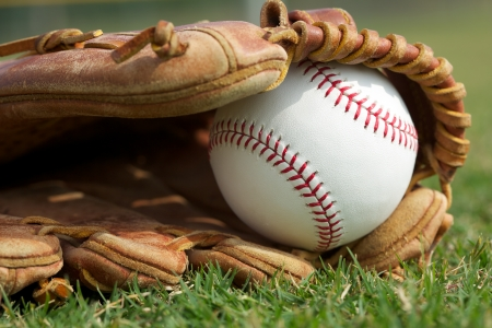 outfield: New Baseball in a Glove on the Outfield Grass