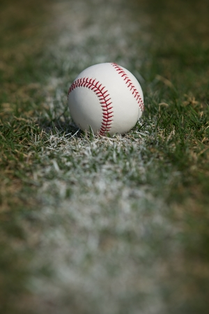 Baseball on the Outfield Chalk Line Stock Photo - 23170742