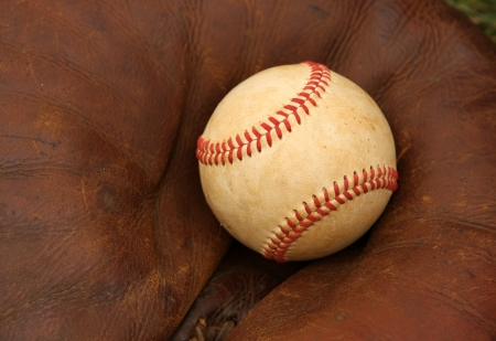 catcher's mitt: Baseball in a Catchers Mitt Stock Photo