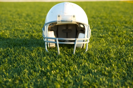 football helmet: American Football Helmet on the Field with room for copy