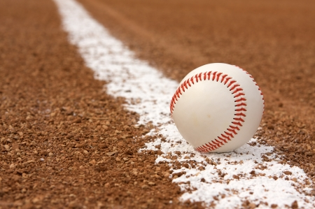 infield: Baseball on a Fresh Infield Chalk Line Stock Photo