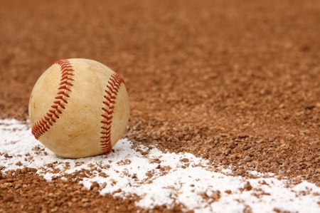 infield: Used Baseball on the Infield Chalk Line