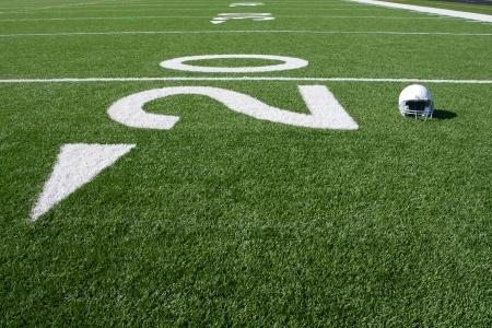 football helmet: American Football Helmet on the Field near the Twenty