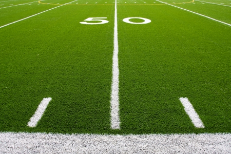 american football background: Fifty Yard Line of a Football Field with hashmarks Stock Photo