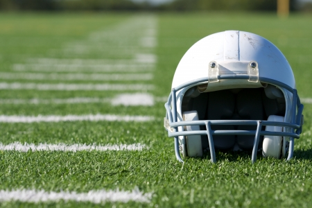 american football field: American Football Helmet on the Field with room for copy