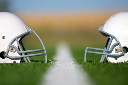 the field and in depth: American Football Helmets Faced Off with Shallow Depth of Field Stock Photo