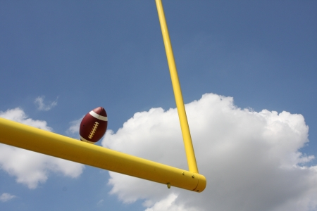 uprights: American Football kicked through the Goal Posts or Uprights Stock Photo