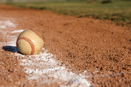 infield: Baseball on the infield chalk line Stock Photo