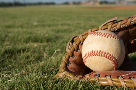 Baseball in a Glove on the field photo