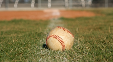 Baseball on the outfield grass Stock Photo - 23750134