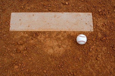 pitchers mound: Baseball near the pitchers mound with room for copy Stock Photo