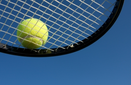 Tennis Ball on a Racket with room for copy