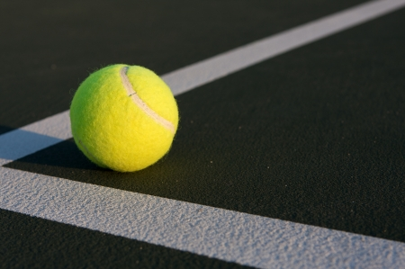 Tennis Ball on the Court with room for copy Imagens