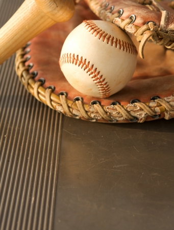 baseball glove: Baseball Bat and Glove on the bench of the dugout