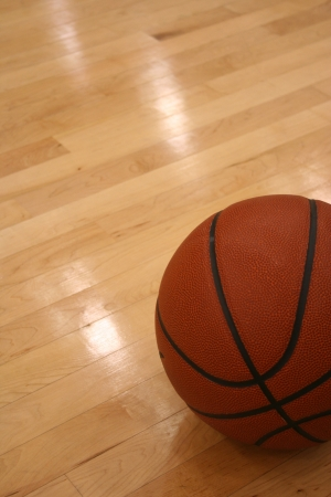 Basketball on the Hardwood Court with room for copy