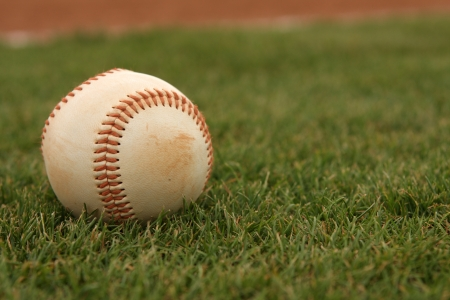outfield: Baseball on the Outfield Grass Stock Photo