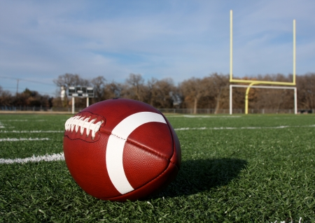 uprights: American Football with the goal posts beyond Stock Photo