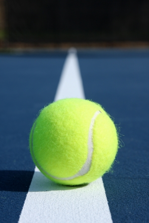 Tennis Ball on a Blue Modern Court photo