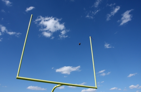 field goal: American Football kicked through the Goal Posts or Uprights Stock Photo