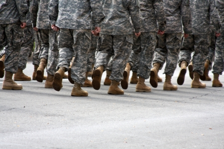 camoflauge: Marching troops or soldiers with room for copy below