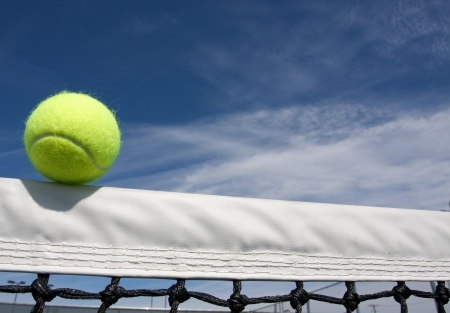 tennis net: Tennis Ball on the Court Net with room for copy Stock Photo