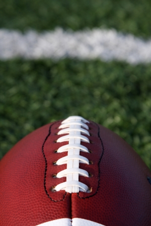 American Football close up with yard line and copy space beyond Stock Photo