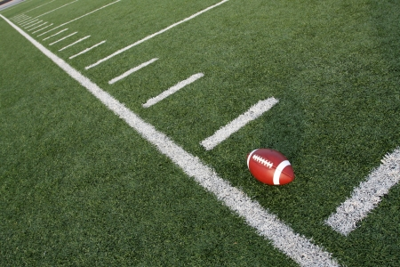 american football field: American Football near the yard lines of a field angled for effect Stock Photo