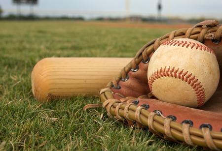 baseball bat: Baseball in a Glove with Bat Stock Photo