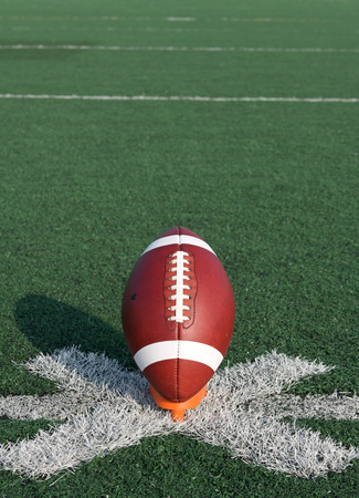 kickoff: American Football ready for kickoff with room for copy above