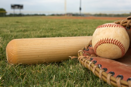 baseball ball: Baseball & Bat on the Field Stock Photo