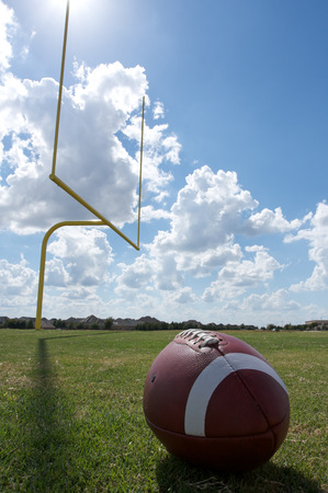 american football background: American Football with the goal posts or uprights in the background