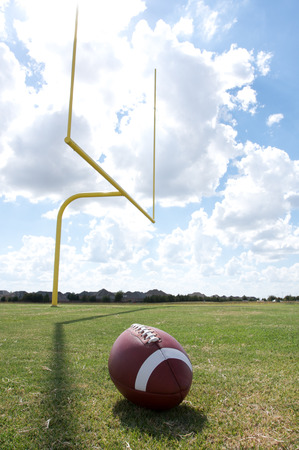 uprights: American Football with the goal posts or uprights in the background