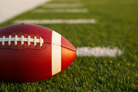 American Football on the Field near with room for copy Stock Photo