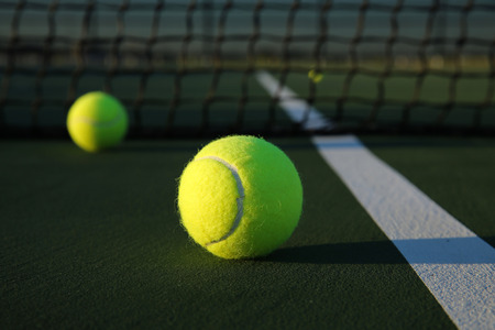 Tennis Balls on the Court Close up with room for copy