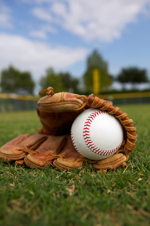 New Baseball in a Glove in the Outfield Stock Photo - 26507986