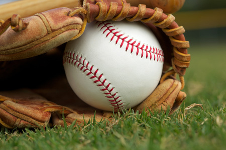 New Baseball in a Glove in the Outfield Stock Photo - 26507991