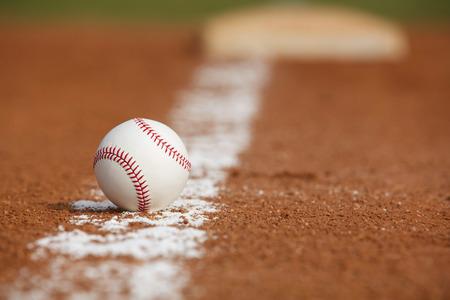 baseball field: Baseball on the Infield Chalk Line Close up