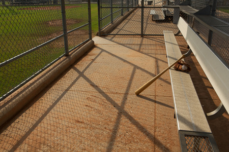 baseball dugout: Baseball & Bat and Glove in the Dugout Stock Photo