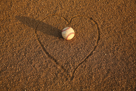 infield: Baseball surrounded by a Heart in the Infield Stock Photo