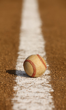 infield: Worn Baseball on the Infield Chalk Line