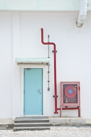 Fire hose cabinet with wall and exit dorr photo