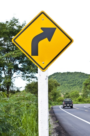 sharp curve: Right sharp curve traffic sign with road background