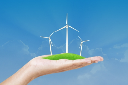 wind turbine in hand on green grass photo