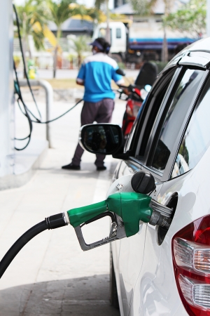 refilling:  Oil refilling in Gas station Stock Photo