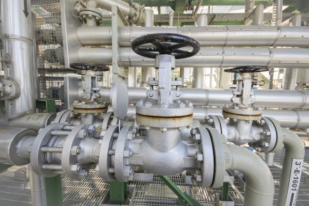 Manual valve with pipe line in industrial plant Stock Photo