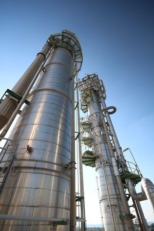 chemical industry: Refinery tower in petrochemical plant with blue sky  Stock Photo